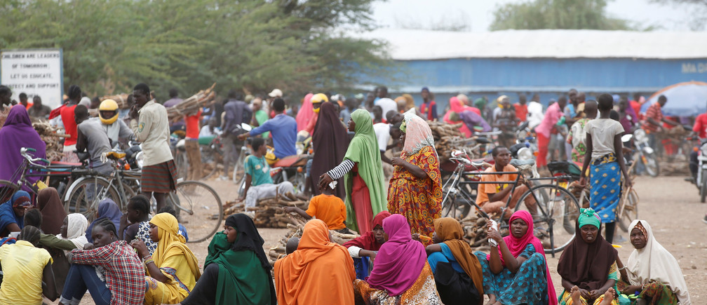 Women wait in line to receive aid at the Kakuma refugee camp