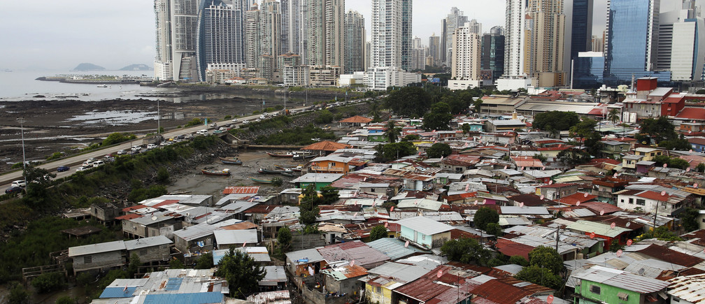A general view of the low-income neighborhood known as Boca la Caja next to the business district in Panama City September 17, 2013. REUTERS/Carlos Jasso (PANAMA - Tags: SOCIETY CITYSCAPE) - GM1E99I0LBP01