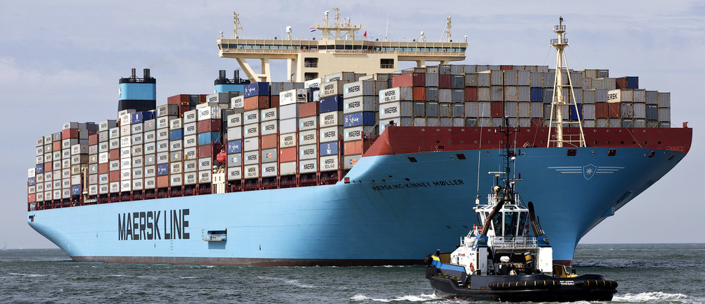 The MV Maersk Mc-Kinney Moller, the world's biggest container ship, arrives at the harbour of Rotterdam August 16, 2013. The 55,000 tonne ship, named after the son of the founder of the oil and shipping group A.P. Moller-Maersk, has a length of 400 meters and cost $185 million. A.P. Moller-Maersk raised its annual profit forecast for the business on Friday, helped by tighter cost controls and lower fuel prices. Maersk shares jumped 6 percent to their highest in 1-1/2 years as investors welcomed a near-doubling of second-quarter earnings at container arm Maersk Line, which generates nearly half of group revenue and is helping counter weakness in the company's oil business. REUTERS/Michael Kooren (NETHERLANDS - Tags: MARITIME TRANSPORT BUSINESS) - GM1E98G1LOZ01