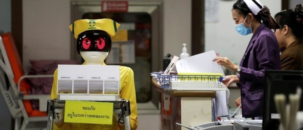 A robot wearing a nurse costume carries medical documents at Mongkutwattana General Hospital in Bangkok, Thailand, February 6, 2019. REUTERS/Athit Perawongmetha TPX IMAGES OF THE DAY - RC16982CDB10