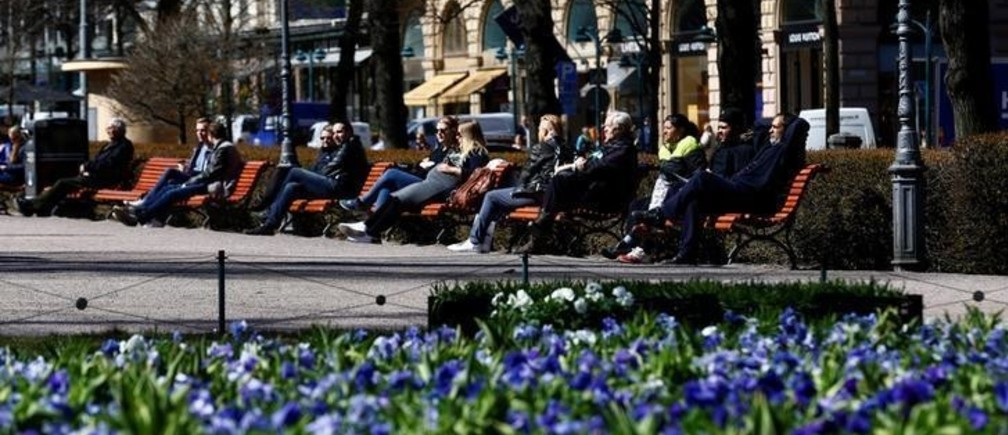 People enjoy a sunnny day at the Esplanade in Helsinki, Finland, May 3, 2017.  REUTERS/Ints Kalnins