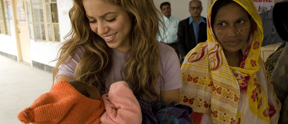UNICEF Goodwill Ambassador Shakira holds a baby at an emergency relief distribution centre for people affected by Cyclone Sidr in Potuakhali District. The infant's mother stands nearby. Clothing and UNICEF family kits are distributed to children and women at the centre.From 17 to 19 December 2007, UNICEF Goodwill Ambassador and internationally acclaimed Colombian singer Shakira Mebarak visited Bangladesh to call attention to the situation of children affected by Cyclone Sidr, a Category 4 storm that struck the country on 15 November.  More than 3,000 people were killed during the cyclone and an estimated 2.6 million people, half of them children, were left in need of life-saving assistance. In Patuakhali, one of the districts devastated by the storm, Shakira visited a UNICEF-supported child friendly space, one of 60 created to provide recreation and psychosocial support to children affected by the cyclone. She also took part in the distribution of UNICEF family kits to children and women. The kits contain 14 essential household items, such as utensils, a bucket, and soap, designed to assist families who have lost their homes. In the north-western district of Rajshahi, Shakira toured two primary schools in small villages and met with adolescent girls from the UNICEF-supported Adolescent Empowerment Project ('Kishori Abhiham'). She also visited a centre for girls who live or work on the streets, as well as a learning centre for child labourers.