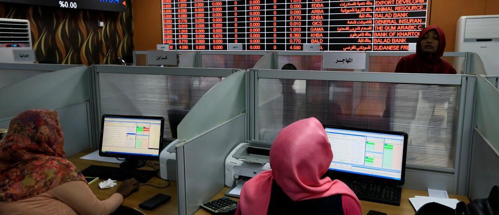 Women work at the Khartoum Stock Exchange in Khartoum, Sudan November 6, 2019. Picture taken November 6, 2019. REUTERS/Mohamed Nureldin Abdallah - RC2CAD9HPPR1