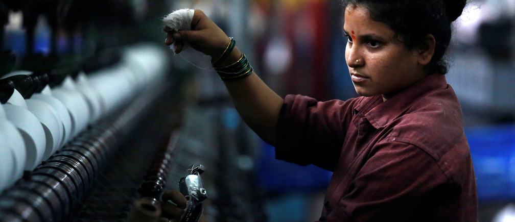 A woman works at a textile mill in Mumbai, India March 8, 2018. REUTERS/Francis Mascarenhas Employees work inside a textile mill of Orient Craft Ltd. at Gurgaon in Haryana, northern India April 16, 2014. When Narendra Modi talks about creating jobs in labour-intensive manufacturing, textile entrepreneur Sudhir Dhingra hopes the Indian opposition leader means business. Dhingra, who employs 30,000 workers in more than 20 factories around the capital New Delhi, says that politicians - for all their promises - have shown no interest in acting to avert a looming employment crisis. Early on, Dhingra survived a change of fashion that saddled him with a pile of unsold stock. Learning his lessons - to keep close tabs on the market and control costs - he built Orient Craft into $250 million business making 200,000 garments daily india women women men female male girls boys teenagers teens development gender gap parity equality diversity progress change feminine masculine woman man sex biology roles dynamic balance bias androgynous