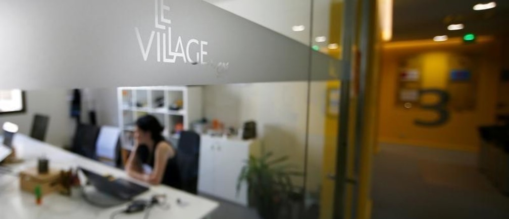 A view shows a working space at Le Village by CA, a value-creating start-up incubator of banking group Credit Agricole, in Paris, France, July 7, 2017. Picture taken July 7, 2017. REUTERS/Gonzalo Fuentes - RC19ED9DDAA0