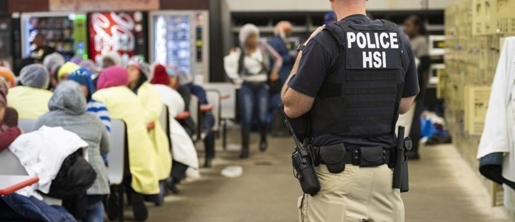 Homeland Security Investigations (HSI) officers from Immigration and Customs Enforcement (ICE) look on after executing search warrants and making some arrests at an agricultural processing facility in Canton, Mississippi, U.S. in this August 7, 2019 handout photo.    Immigration and Customs Enforcement/Handout via REUTERS  ATTENTION EDITORS - THIS IMAGE WAS PROVIDED BY A THIRD PARTY. - RC153B4D8800