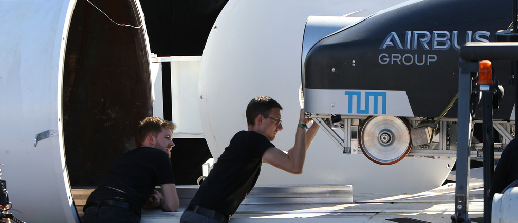Team members from WARR Hyderloop, Technical University of Munich place their pod on the track during the SpaceX Hyperloop Pod Competition in Hawthorne, Los Angeles, California, U.S., January 29, 2017. REUTERS/Monica Almeida - RTSY001