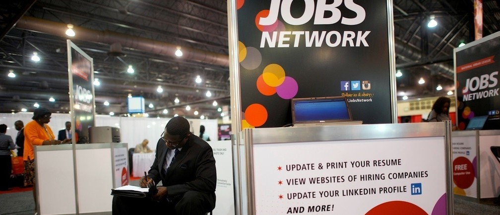 A job-seeker completes an application at a career job fair in Philadelphia, Pennsylvania, U.S
