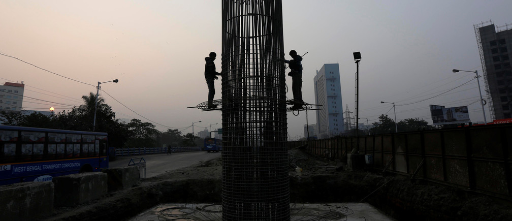 Labourers work at the construction site of a metro rail project in Kolkata, India, February 1, 2017.