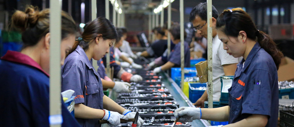 Employees work on a production line manufacturing tools at a factory in Huaian, Jiangsu province, China May 26, 2019. Picture taken May 26, 2019. REUTERS/Stringer ATTENTION EDITORS - THIS IMAGE WAS PROVIDED BY A THIRD PARTY. CHINA OUT. - RC1E85B3F500