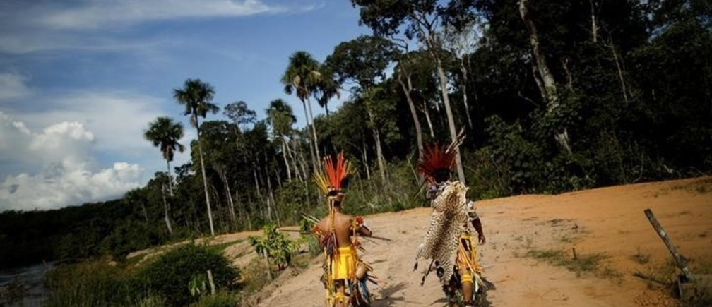 """Indigenous people of the Pareci community walk in the village of Wazare near the town of Campo Novo do Parecis, Brazil, April 26, 2018. REUTERS/Ueslei Marcelino    SEARCH """"INDIGENOUS SOY"""" FOR THIS STORY. SEARCH """"WIDER IMAGE"""" FOR ALL STORIES."""