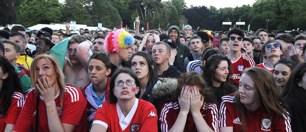 Welsh fans show their disappointment after Belgium scored their first goal, to be shown on a giant screen in the Fanzone, Coopers Field, Cardiff, Wales, July 1, 2016.  REUTERS/Rebecca Naden