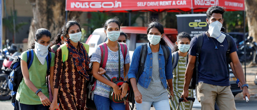 A group of students wearing protective masks walk outside a railway station amid coronavirus fears, in Kochi, India, March 10, 2020. REUTERS/Sivaram V - RC20HF93NFZU