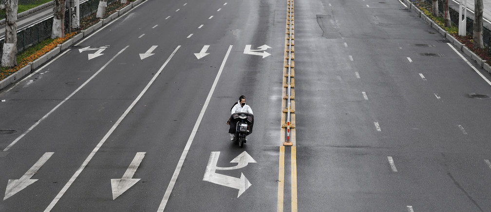 People ride an electric bike on a road in Wuhan, the epicentre of the novel coronavirus outbreak, Hubei province, China March 3, 2020. REUTERS/Stringer  CHINA OUT. - RC2DCF9VCWNQ
