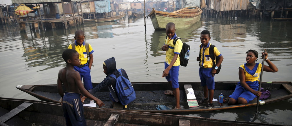 "Students who attend a floating school travel on a canoe to school in the Makoko fishing community on the Lagos Lagoon, Nigeria February 29, 2016. In Makoko, a sprawling slum of Nigeria's megacity Lagos, a floating school capable of holding up to a hundred pupils has since November brought free education to the waterways known as the Venice of Lagos. It offers the chance of social mobility for youngsters who, like most of the city's 21 million inhabitants, lack a reliable electricity and water supply and whose water-based way of life is threatened by climate change as well as rapid urbanisation. REUTERS/Akintunde Akinleye SEARCH ""THE WIDER IMAGE"" FOR ALL STORIES  - GF10000333177"