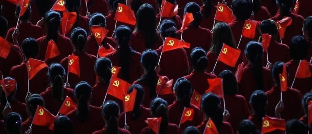 Performers hold flags of the Communist Party of China (CPC) during an event to celebrate the upcoming 90th anniversary of the founding of the party, at the Mercedes-Benz Arena in Shanghai June 30, 2011.