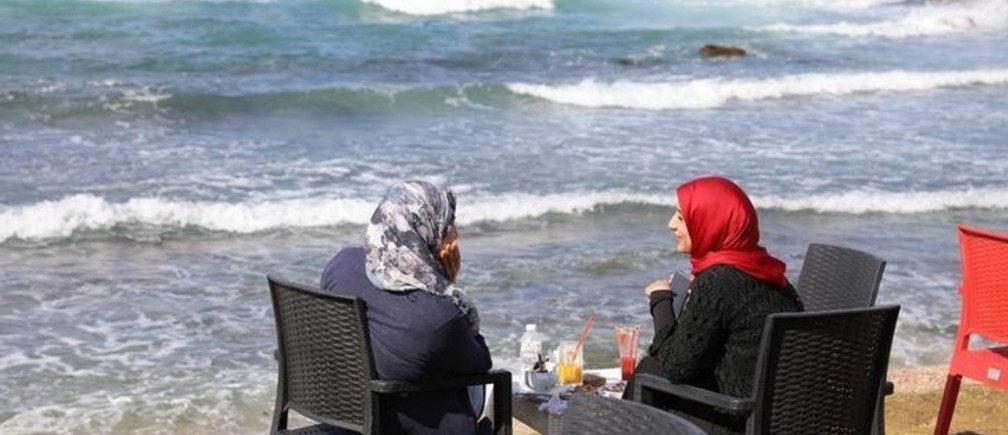 Women sit at a cafe on a beach in Tripoli, Libya October 28, 2017. Picture taken October 28, 2017. REUTERS/Hani Amara