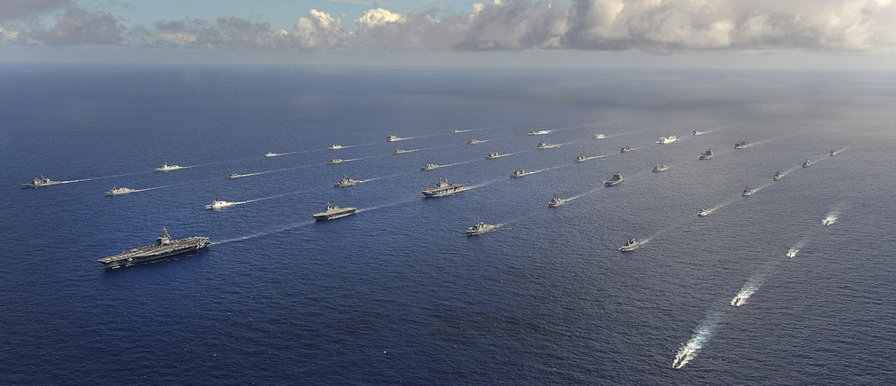 More than 40 ships and submarines representing 15 international partner nations travel in formation in the Pacific Ocean during the Rim of the Pacific (RIMPAC) 2014 exercise in this U.S. Navy photo taken July 25, 2014, and released July 31, 2014.  RIMPAC is a U.S. Pacific Fleet-hosted biennial multinational maritime exercise.  REUTERS/U.S. Navy/Mass Communication Specialist 1st Class Shannon E. Renfroe/Handout  (UNITED STATES - Tags: MILITARY POLITICS) THIS IMAGE HAS BEEN SUPPLIED BY A THIRD PARTY. IT IS DISTRIBUTED, EXACTLY AS RECEIVED BY REUTERS, AS A SERVICE TO CLIENTS. FOR EDITORIAL USE ONLY. NOT FOR SALE FOR MARKETING OR ADVERTISING CAMPAIGNS - TM3EA7V187V01