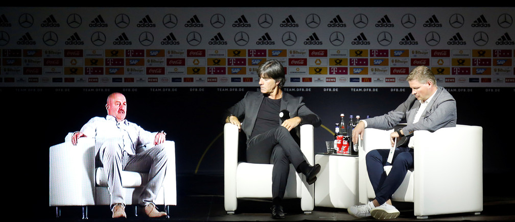 Soccer Football - Germany - Joachim Loew Press Conference - German Football Museum, Dortmund, Germany - May 15, 2018    Germany coach Joachim Loew and team manager Oliver Bierhoff with a hologram of Russia coach Stanislav Cherchesov during the press conference   REUTERS/Leon Kuegeler - RC181B9979E0