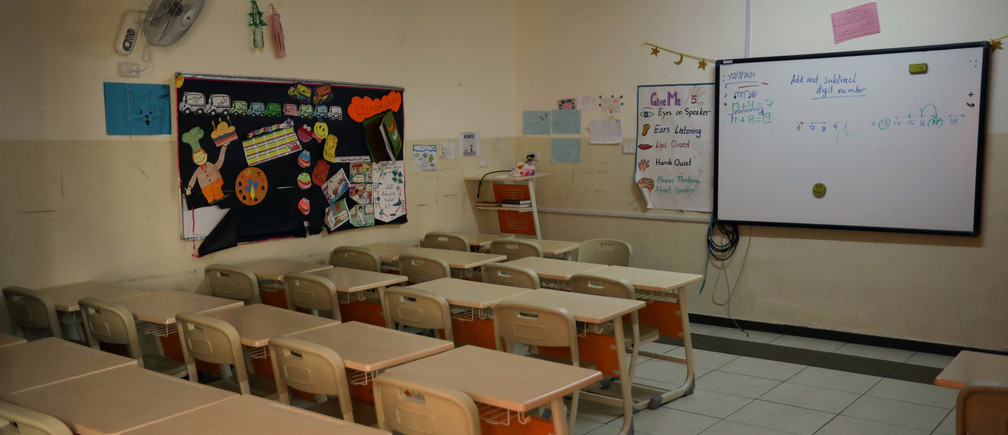 Empty desks are pictured in a deserted class in one of the schools, amid concerns over the spread of coronavirus disease (COVID-19), in Amman, Jordan March 23, 2020. Picture taken March 23, 2020 Coronavirus china virus health healthcare who world health organization disease deaths pandemic epidemic worries concerns Health virus contagious contagion viruses diseases disease lab laboratory doctor health dr nurse medical medicine drugs vaccines vaccinations inoculations technology testing test medicinal biotechnology biotech biology chemistry physics microscope research influenza flu cold common cold bug risk symptomes respiratory china iran italy europe asia america south america north washing hands wash hands coughs sneezes spread spreading precaution precautions health warning covid 19 cov SARS 2019ncov wuhan sarscow wuhanpneumonia  pneumonia outbreak patients unhealthy fatality mortality elderly old elder age serious death deathly deadly