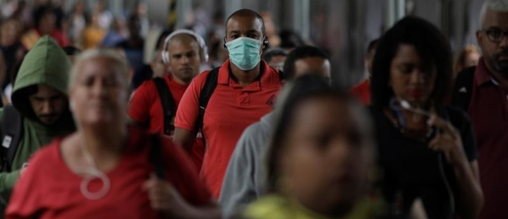 A passenger wearing a protective mask walks at Central do Brasil train station after reports of coronavirus disease (COVID-19) in Rio de Janeiro, Brazil, March 17, 2020. REUTERS/Ricardo Moraes - RC2QLF9D1DRJ