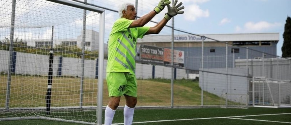 Isaak Hayik, 73 years old, breaks the Guinness World Record for oldest living football player while playing in a goalkeeper position in a game with Israel's Ironi Or Yehuda soccer club, in Or Yehuda, Israel April 5, 2019. REUTERS/Amir Cohen - RC12535B9370