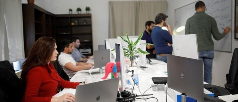 Employees of the D-ID startup company work at the company's office in Tel Aviv, Israel February 7, 2018. Picture taken February 7, 2018. REUTERS/Amir Cohen