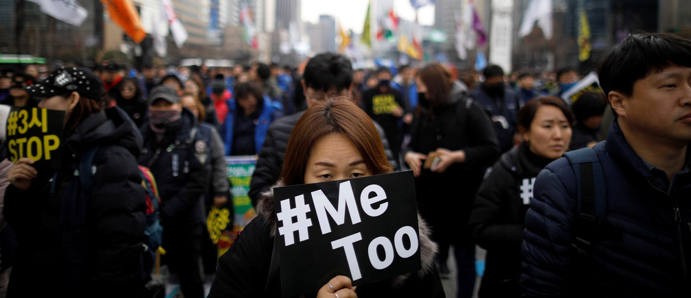 People attend a protest on International Women's Day in Seoul, South Korea.