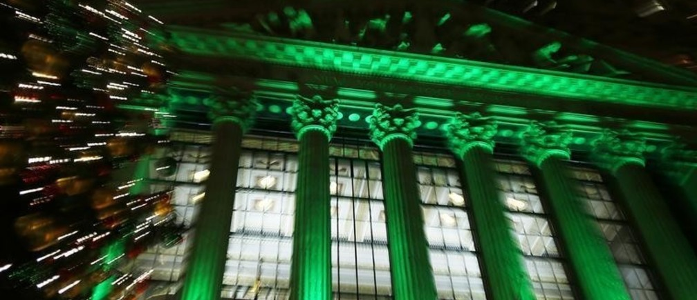 The New York Stock Exchange is seen lit up in green as part of Christmas preparations in New York, December 11, 2012. REUTERS/Carlo Allegri  (UNITED STATES - Tags: BUSINESS) - GM1E8CC12P101