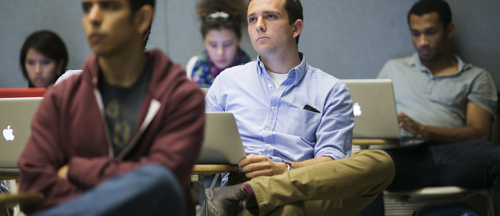 Students at Stanford University listen during a presentation.