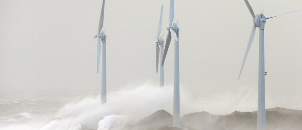 Waves crash against wind turbines during a storm named Christian that battered France at Boulogne sur Mer, northern France, October 28, 2013. REUTERS/Pascal Rossignol (FRANCE - Tags: ENVIRONMENT) - PM1E9AS116E01
