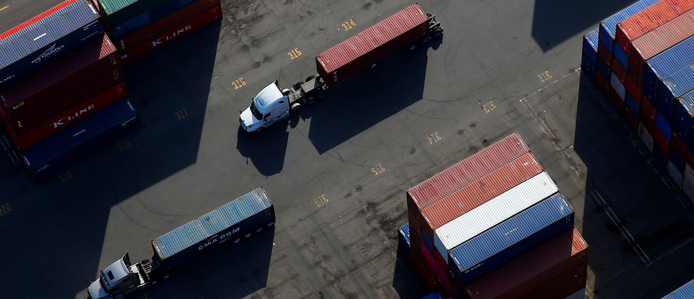 An aerial photo shows shipping containers loaded onto trucks at Harbor Island at the Port of Seattle in Seattle, Washington, U.S. March 21, 2019. Picture taken March 21, 2019.  REUTERS/Lindsey Wasson - RC18C2BA6FF0