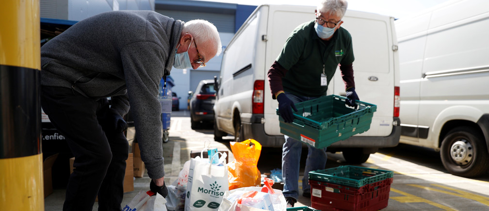 Volunteers at the North Enfield Foodbank Charity unload donations for the foodbank in Enfield as the spread of coronavirus disease (COVID-19) continues in London, Britain March 24, 2020.