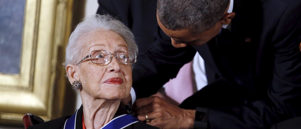 U.S. President Barack Obama presents the Presidential Medal of Freedom to NASA mathematician Katherine G. Johnson during an event in the East Room of the White House in Washington November 24, 2015. Johnson is a pioneer in American space history. REUTERS/Carlos Barria - GF20000072843