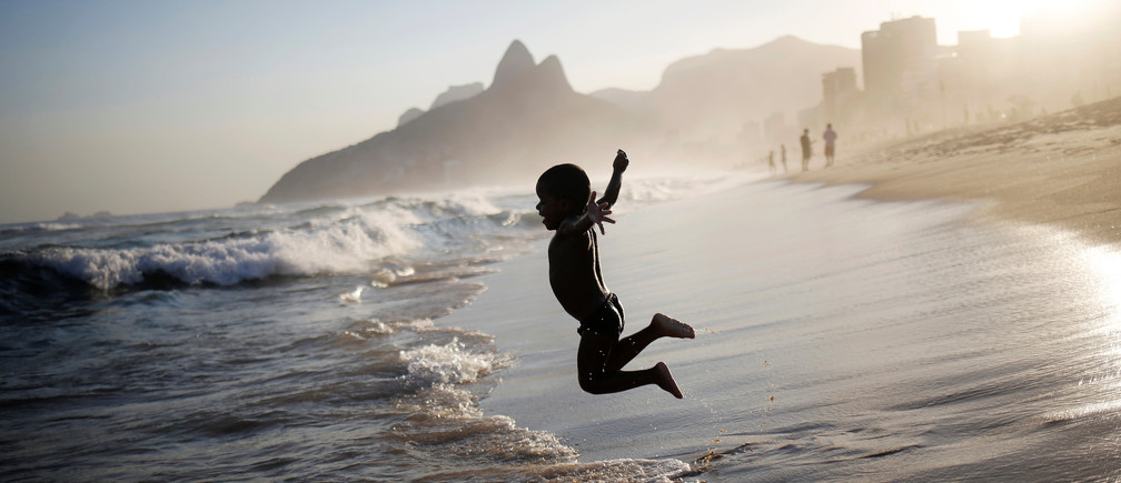 A boy jumps on Ipanema beach in Rio de Janeiro, Brazil, May 3, 2016.