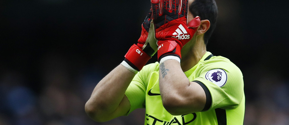 "Britain Football Soccer - Manchester City v Chelsea - Premier League - Etihad Stadium - 3/12/16 Manchester City's Claudio Bravo looks dejected  Action Images via Reuters / Jason Cairnduff Livepic EDITORIAL USE ONLY. No use with unauthorized audio, video, data, fixture lists, club/league logos or ""live"" services. Online in-match use limited to 45 images, no video emulation. No use in betting, games or single club/league/player publications. Please contact your account representative for further details. - RTSUGNQ"