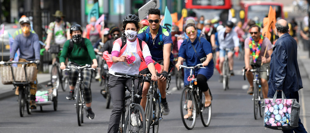 Members of Extinction Rebellion take part in a socially distanced bicycle ride to campaign for more cycling and cycle lanes and fewer vehicles on the roads, following the outbreak of the coronavirus disease (COVID-19), London, Britain, May 17, 2020. REUTERS/Toby Melville - RC2EQG9PJ76S