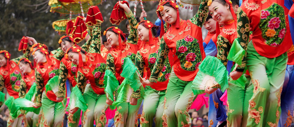 Folk artists from Hebei province dance at a Spring Festival Temple Fair in Beijing, China