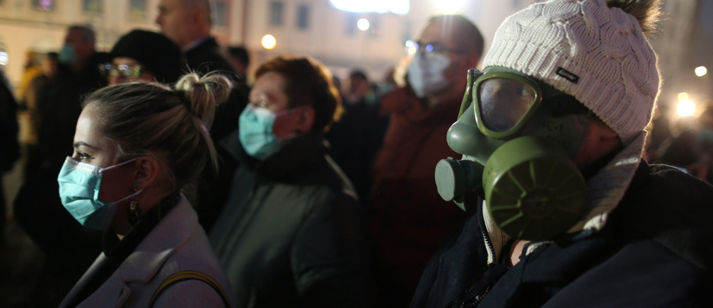 A demonstrator wears a gas mask during a protest over lacking measures to tackle heavy air pollution in Tuzla, Bosnia and Herzegovina environment energy change transition friendly environment carbon footprint carbon emissions reduction change natural climate change global warming air pollution clean energy power renewables