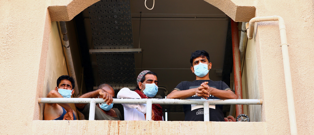Workers wear masks during the outbreak of the coronavirus disease (COVID-19) in Dubai, United Arab Emirates April 23, 2020.