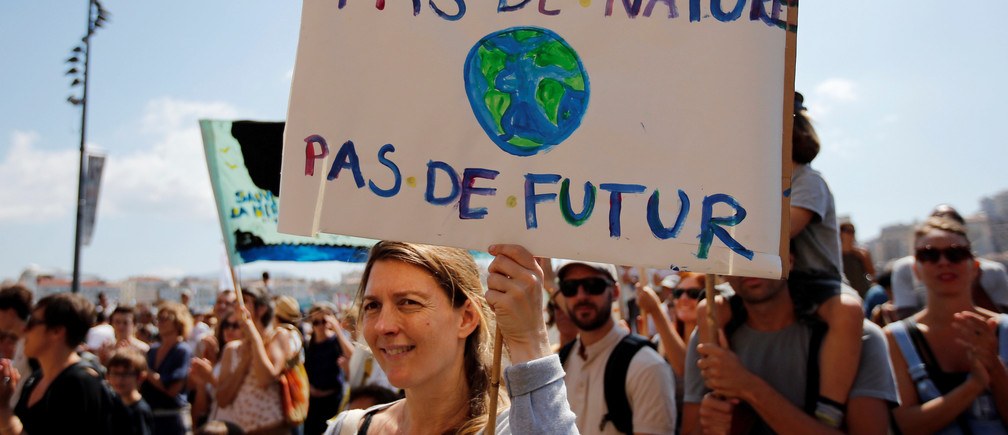 """Environmental activists gather to urge world leaders to take action against climate change in Marseille, France,  September 8, 2018. The placard reads """"No nature, no future"""".   REUTERS/Jean-Paul Pelissier - RC1DD30FD7E0"""