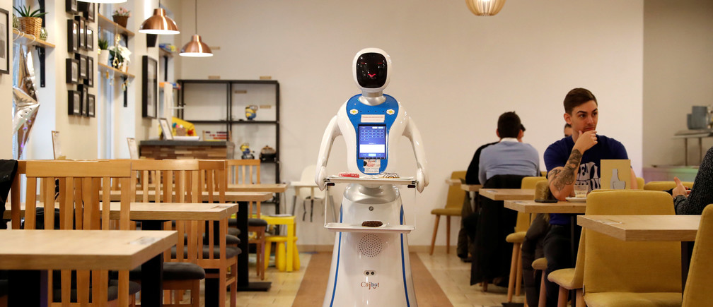 A robot waiter serves customers at a cafe in Budapest, Hungary, January 24, 2019. Picture taken January 24, 2019. REUTERS/Bernadett Szabo - RC141F8D1790