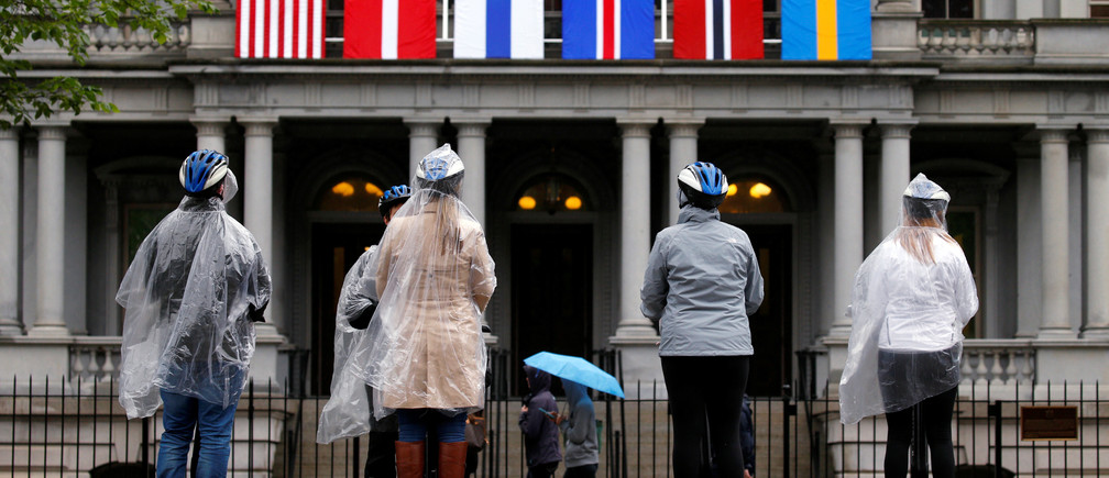 A segway tour stops in front of flags of the Nordic nations hanging from the Eisenhower Executive Office Building beside the White House in Washington, May 11, 2016. On Friday, U.S. President Barack Obama will host the leaders of Denmark, Finland, Iceland, Norway and Sweden for a U.S.-Nordic Leaders Summit. REUTERS/Kevin Lamarque - S1BETDMHQOAA