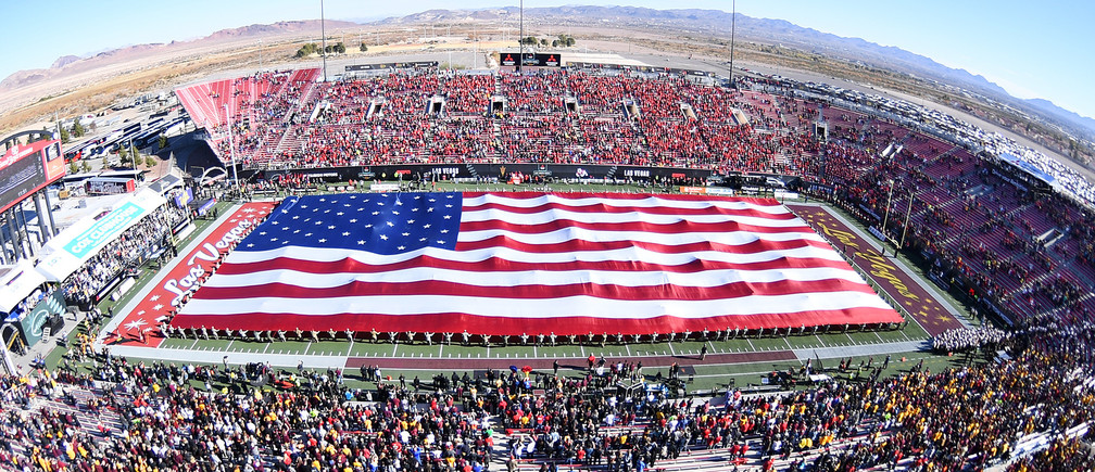 Dec 15, 2018; Las Vegas, NV, United States; The flag is presented during the performance of the National Anthem before the start of the Las Vegas Bowl at Sam Boyd Stadium. Mandatory Credit: Stephen R. Sylvanie-USA TODAY Sports - 11851246