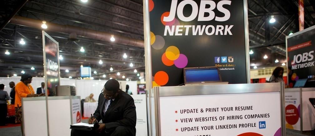 A job-seeker completes an application at a career job fair in Philadelphia, Pennsylvania, U.S. July 25, 2013