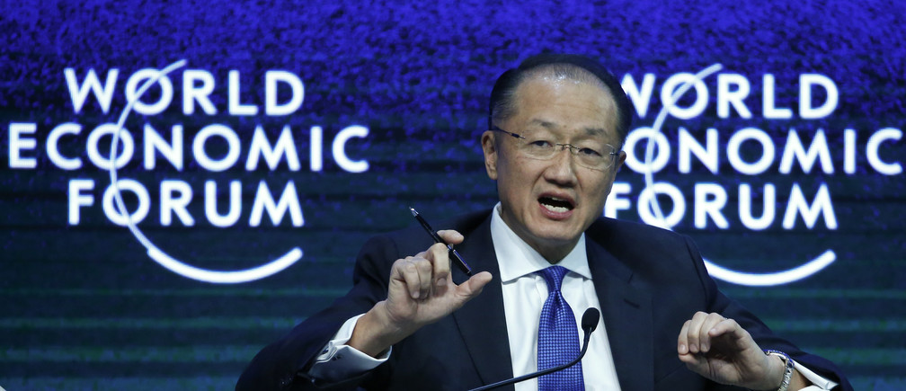 World Bank President Jim Yong Kim speaks during the session 'Tackling Climate, Development and Growth' in the Swiss mountain resort of Davos January 23, 2015. More than 1,500 business leaders and 40 heads of state or government attend the Jan. 21-24 meeting of the World Economic Forum (WEF) to network and discuss big themes, from the price of oil to the future of the Internet. This year they are meeting in the midst of upheaval, with security forces on heightened alert after attacks in Paris, the European Central Bank considering a radical government bond-buying programme and the safe-haven Swiss franc rocketing.      REUTERS/Ruben Sprich (SWITZERLAND  - Tags: BUSINESS POLITICS) - LR2EB1N0TCMRO