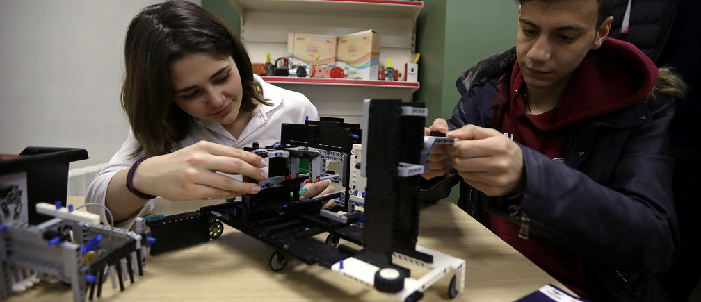 Students work on programming and developing their robots to work in a virtual space station at Jubilee School in Amman, Jordan, February 10, 2019. REUTERS/Muhammad Hamed - RC166910D210