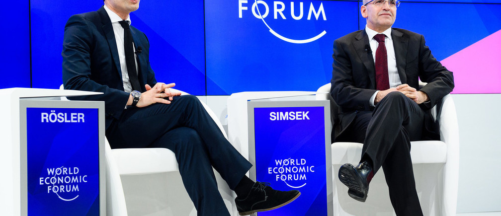 "Mehmet Simsek, Deputy Prime Minister of Turkey and Philipp Rösler, Head, Regional and Government Engagement, Member of the Managing Board, World Economic Forum speaking during the Session ""A Conversation with Mehmet Simsek, Deputy Prime Minister of Turkey"" at the Annual Meeting 2017 of the World Economic Forum in Davos, January 20, 2017. .Copyright by World Economic Forum / Manuel Lopez"