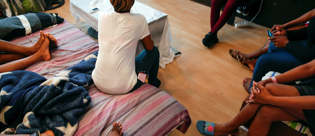 Young Nigerian women, rescued from human traffickers, gather in a shelter on the outskirts of Moscow, Russia February 21, 2019. Picture taken February 21, 2019. REUTERS/Maxim Shemetov - RC12B8705CF0