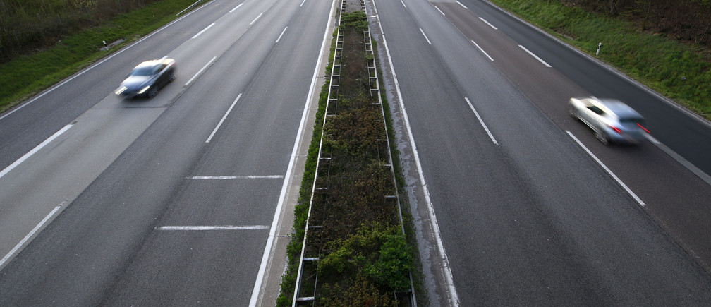 Cars drive on the highway A3 during the spread of the coronavirus disease (COVID-19) near Montabaur, Germany, April 15, 2020. REUTERS/Thilo Schmuelgen - RC295G9S5VDJ